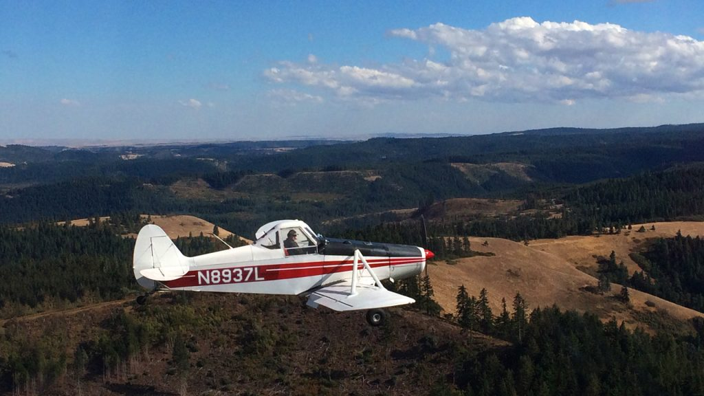 Our sturdy tow plane flying above the ridge